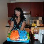 Sam presents the Blob cake she provided